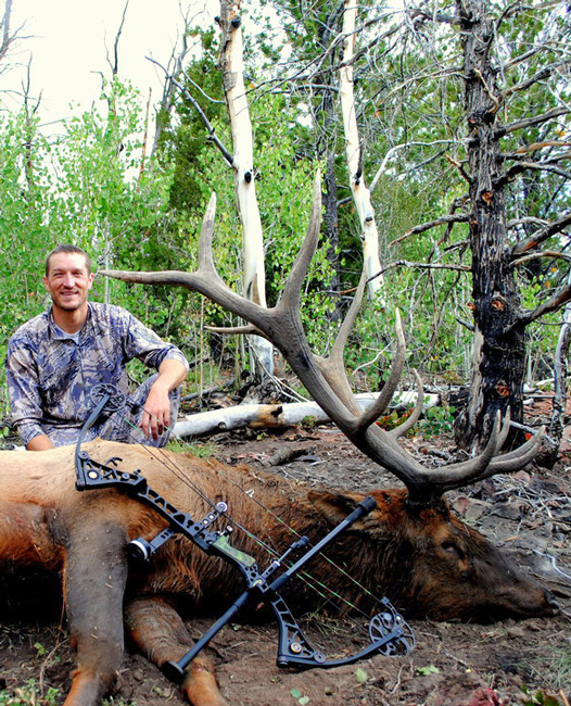 Trail Kreitzer with archery bull elk taken off a wallow