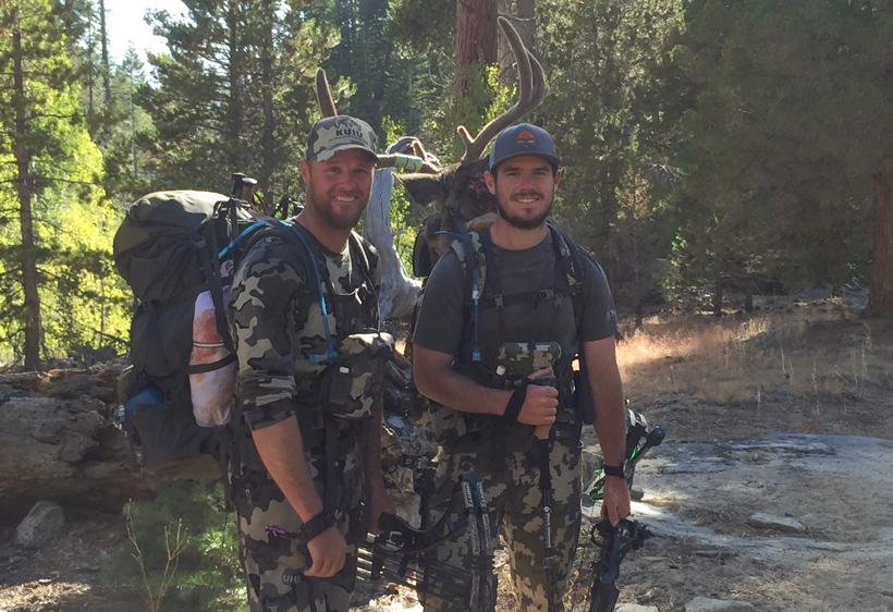 Travis Stone and Brett packing out a California archery blacktail buck