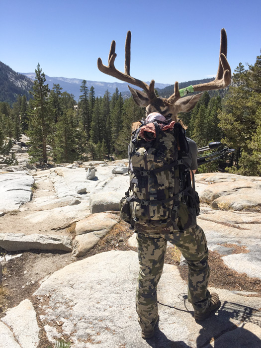 Travis Stone packing out his archery California blacktail deer