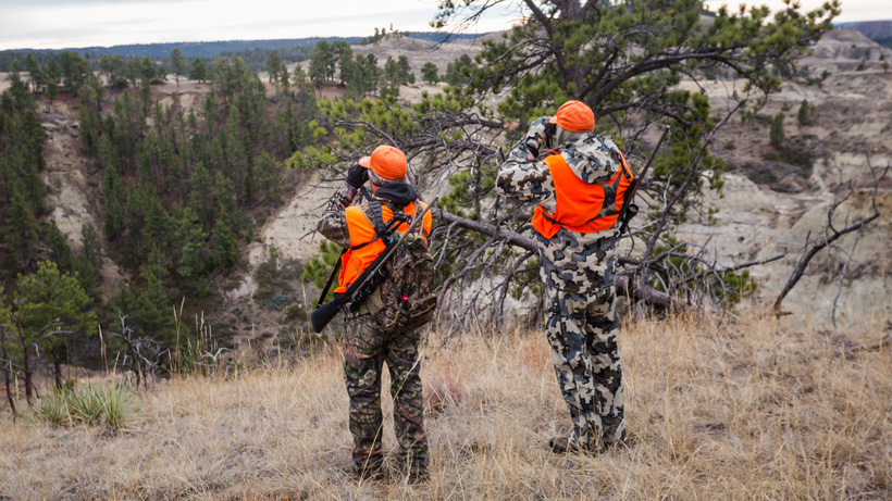 Two hunters glassing for deer