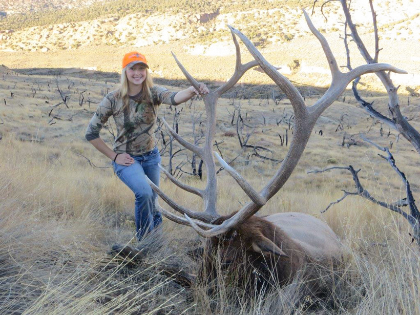 Tyler Cantrell with her Wyoming bull elk side view