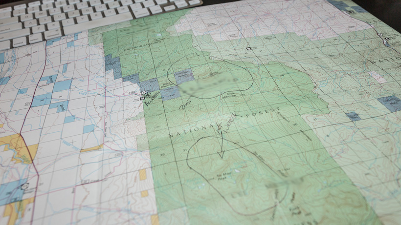 Using a map while calling a biologist for hunting information
