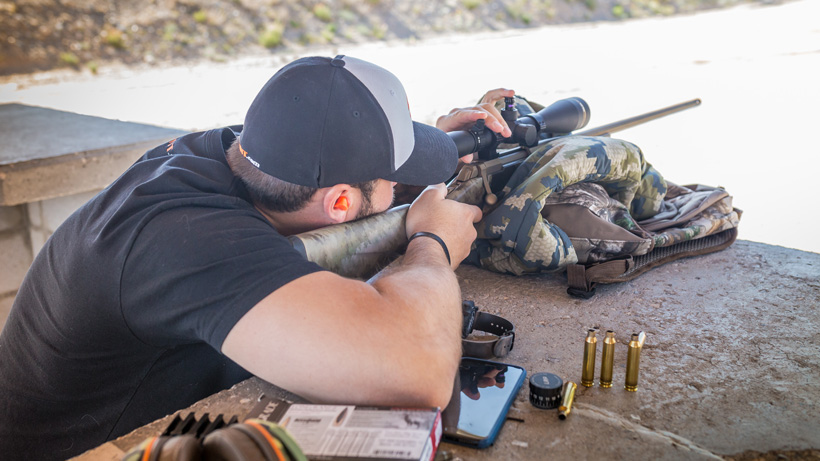 Using hearing protection while shooting Browning X-bolt rifle