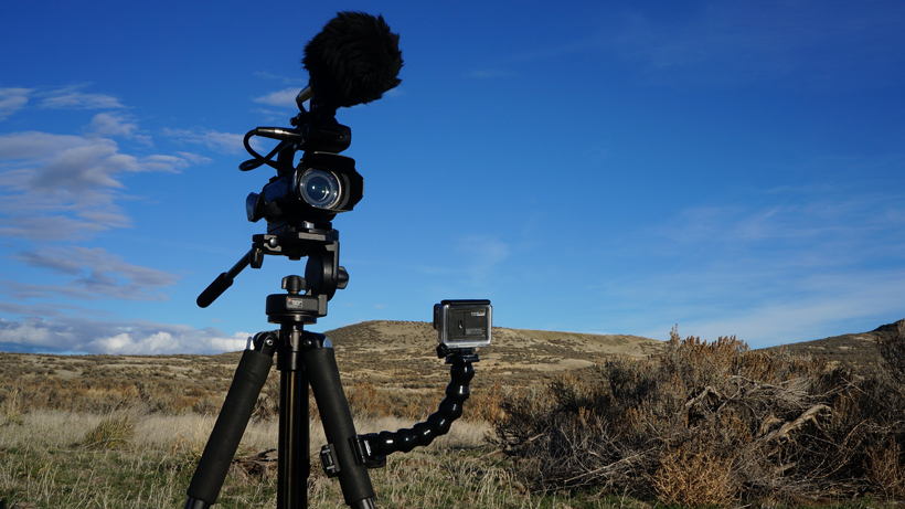 Video camera and GoPro mounted on tripod