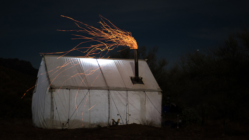 Wall tent photo at night with camp stove