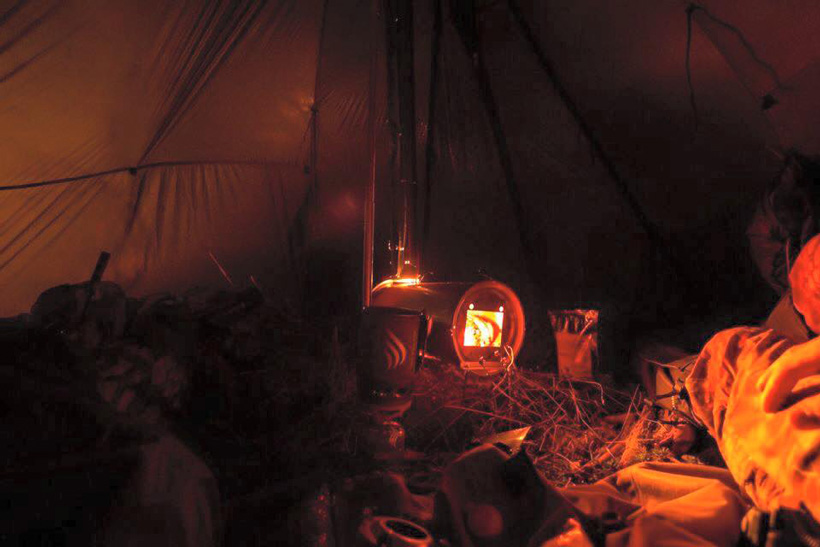 Warm stove in the Kifaru Sawtooth tipi shelter
