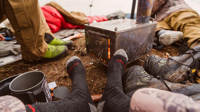Warming feet up near wood burning stove