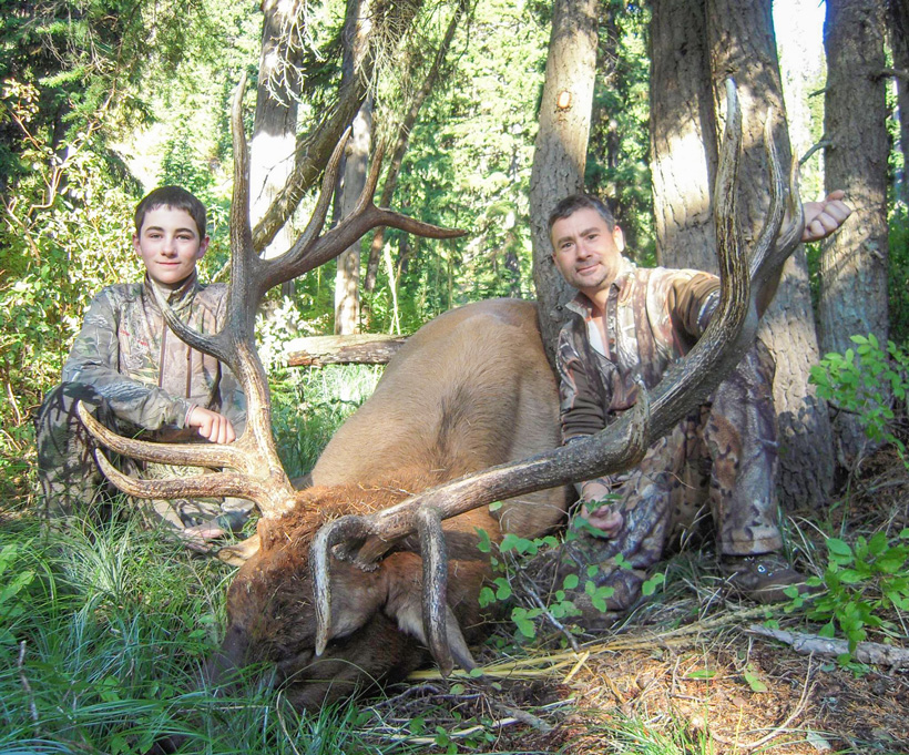 Wyatt O'Day with his giant Montana archery elk with his dad