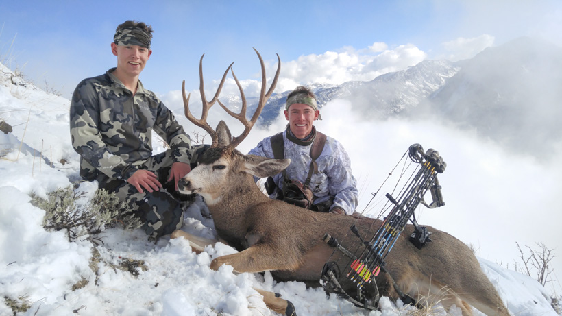 Zach Davis and his brother with his Utah extended archery mule deer