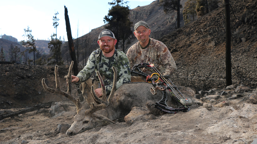 Zach Kenner and father with his archery velvet mule deer