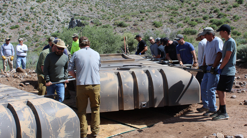 Moving water tanks into place