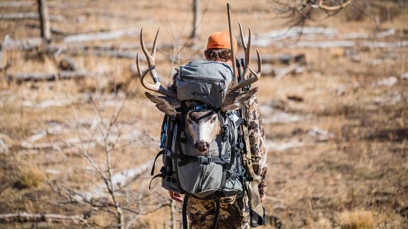 Brady Miller packing out his muzzy mule deer