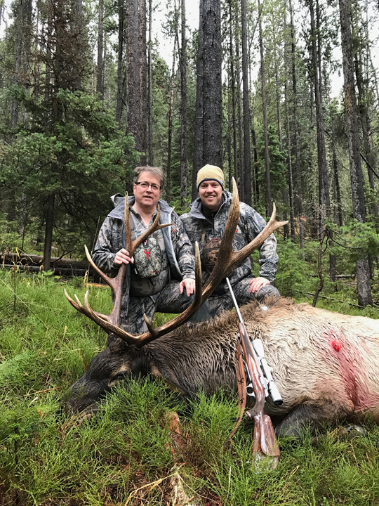 Dad and I with his bull elk